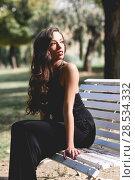 Купить «Portrait of pretty girl with long hair wearing black clothes in a park», фото № 28534332, снято 18 ноября 2014 г. (c) Ingram Publishing / Фотобанк Лори