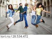 Купить «Multi-ethnic group of young people having fun together outdoors in urban background. group of people jumping together», фото № 28534472, снято 23 апреля 2017 г. (c) Ingram Publishing / Фотобанк Лори