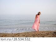 Купить «Portrait of a beautiful woman with long pink dress and sun hat on a tropical beach», фото № 28534532, снято 30 июля 2012 г. (c) Ingram Publishing / Фотобанк Лори