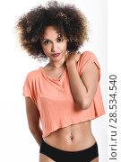 Купить «Young black woman with afro hairstyle. Girl wearing t-shirt and black panties. Studio shot.», фото № 28534540, снято 14 июня 2016 г. (c) Ingram Publishing / Фотобанк Лори
