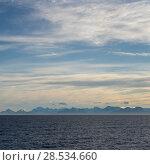 Sea with mountain range in the background, Norway. Стоковое фото, фотограф Keith Levit / Ingram Publishing / Фотобанк Лори