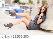 Купить «Portrait of a funny woman, model of fashion, with high heels moving her legs», фото № 28535280, снято 19 декабря 2013 г. (c) Ingram Publishing / Фотобанк Лори