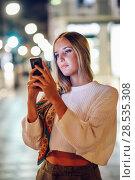 Купить «Woman taking photograph with smartphone at night in the street», фото № 28535308, снято 20 сентября 2017 г. (c) Ingram Publishing / Фотобанк Лори