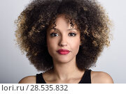 Купить «Young black woman with afro hairstyle on white background. Girl with african hairstyle. Studio shot.», фото № 28535832, снято 14 июня 2016 г. (c) Ingram Publishing / Фотобанк Лори