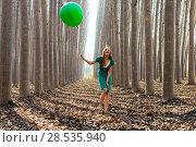 Купить «Beautiful blonde girl, dressed in green, laughing in the forest», фото № 28535940, снято 4 декабря 2011 г. (c) Ingram Publishing / Фотобанк Лори