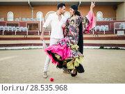 Купить «Portrait of a pretty couple, models of fashion, in a bullring. Spanish style», фото № 28535968, снято 15 декабря 2013 г. (c) Ingram Publishing / Фотобанк Лори