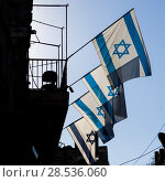 Low angle view of Israeli Flags on building in the Old City of Jerusalem, Israel. Стоковое фото, фотограф Keith Levit / Ingram Publishing / Фотобанк Лори