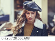 Купить «Blonde russian woman in urban background. Beautiful young girl wearing beret, black leather jacket and mini skirt standing in the street. Pretty female with long wavy hair hairstyle.», фото № 28536608, снято 24 января 2017 г. (c) Ingram Publishing / Фотобанк Лори