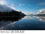 Купить «Reflection of trees in water, Furry Creek, British Columbia, Canada», фото № 28536820, снято 22 марта 2016 г. (c) Ingram Publishing / Фотобанк Лори