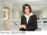 Купить «Portrait of business woman in modern office interior», фото № 28537056, снято 14 января 2014 г. (c) Ingram Publishing / Фотобанк Лори