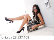 Купить «Funny female model at fashion with high heels sitting on the floor», фото № 28537108, снято 9 октября 2011 г. (c) Ingram Publishing / Фотобанк Лори