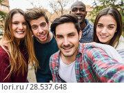 Купить «Group of multi-ethnic young people having fun together outdoors in urban background», фото № 28537648, снято 22 марта 2015 г. (c) Ingram Publishing / Фотобанк Лори