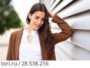 Купить «Young woman with nice wavy long hair. Beautiful girl wearing formal wear. Young female with brown jacket.», фото № 28538216, снято 30 апреля 2017 г. (c) Ingram Publishing / Фотобанк Лори