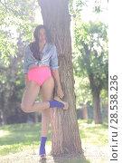 Купить «Portrait of a beautiful young woman, model of fashion, in a garden wearing pink panties and haigh heels», фото № 28538236, снято 18 мая 2013 г. (c) Ingram Publishing / Фотобанк Лори