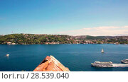 Купить «Bridge on Bosphorus connecting the european waterside of Istanbul with the asian waterside on background of blue sky», видеоролик № 28539040, снято 4 июня 2018 г. (c) Mikhail Starodubov / Фотобанк Лори