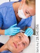 Купить «Female specialist is doing injection to client for anti-aging», фото № 28540056, снято 19 октября 2018 г. (c) Яков Филимонов / Фотобанк Лори
