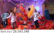 Купить «Children play and frolic with plastic bags in the cafe», видеоролик № 28543348, снято 4 марта 2018 г. (c) Олег Хархан / Фотобанк Лори