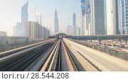 Купить «Skyscrapers business center on blue sky background and Metro Train in Dubai, United Arab Emirates», видеоролик № 28544208, снято 2 июня 2018 г. (c) Mikhail Starodubov / Фотобанк Лори