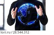 Купить «man working with 3d earth planet hologram», видеоролик № 28544312, снято 22 мая 2019 г. (c) Syda Productions / Фотобанк Лори