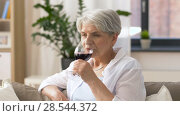 Купить «senior woman drinking red wine from glass at home», видеоролик № 28544372, снято 29 мая 2018 г. (c) Syda Productions / Фотобанк Лори