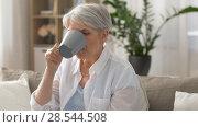 Купить «senior woman drinking tea at home», видеоролик № 28544508, снято 30 мая 2018 г. (c) Syda Productions / Фотобанк Лори