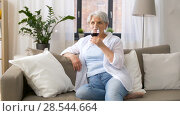Купить «senior woman drinking red wine from glass at home», видеоролик № 28544664, снято 30 мая 2018 г. (c) Syda Productions / Фотобанк Лори