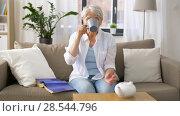 Купить «senior woman drinking tea at home», видеоролик № 28544796, снято 29 мая 2018 г. (c) Syda Productions / Фотобанк Лори