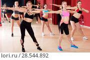 Купить «Active females dancing excited posing», фото № 28544892, снято 31 мая 2017 г. (c) Яков Филимонов / Фотобанк Лори