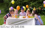 Купить «happy kids on birthday party at summer garden», видеоролик № 28545036, снято 5 июня 2018 г. (c) Syda Productions / Фотобанк Лори