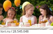 Купить «happy kids on birthday party at summer garden», видеоролик № 28545048, снято 5 июня 2018 г. (c) Syda Productions / Фотобанк Лори