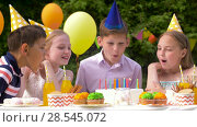 Купить «happy kids on birthday party at summer garden», видеоролик № 28545072, снято 5 июня 2018 г. (c) Syda Productions / Фотобанк Лори