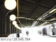Stockholm, Sweden Pedestrian in a public transit tunnel at Gullmarsplan. (2018 год). Редакционное фото, фотограф A. Farnsworth / age Fotostock / Фотобанк Лори