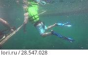 Купить «Underwater view of people snorkeling in Andaman Sea», видеоролик № 28547028, снято 3 июня 2018 г. (c) Игорь Жоров / Фотобанк Лори