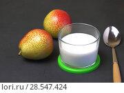 Купить «Food. Dessert of milk. Dairy product on a black background. Creamy yogurt in a glass jar with fresh pears for a healthy diet.», фото № 28547424, снято 27 мая 2018 г. (c) Светлана Евграфова / Фотобанк Лори