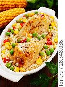 Купить «Chicken legs baked with rice and vegetables», фото № 28548036, снято 6 марта 2018 г. (c) Надежда Мишкова / Фотобанк Лори