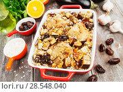 Купить «Chicken thigh baked with rice, eggplant and figs», фото № 28548040, снято 10 марта 2018 г. (c) Надежда Мишкова / Фотобанк Лори