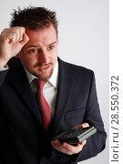 Купить «Young business man with calculator», фото № 28550372, снято 12 ноября 2019 г. (c) age Fotostock / Фотобанк Лори
