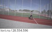 Купить «Electric Longboard summer ride on red sport stadium with playground», видеоролик № 28554596, снято 9 июня 2018 г. (c) Aleksejs Bergmanis / Фотобанк Лори