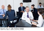 Купить «Managers with laptops having a productive day», фото № 28554948, снято 28 октября 2016 г. (c) Яков Филимонов / Фотобанк Лори