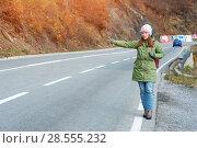 Купить «Woman tourist hitch-hiking on the road», фото № 28555232, снято 20 ноября 2017 г. (c) Pavel Biryukov / Фотобанк Лори