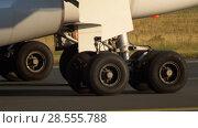 Купить «Airplane gear close-up», видеоролик № 28555788, снято 12 апреля 2018 г. (c) Игорь Жоров / Фотобанк Лори
