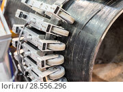 Купить «Automatic system of nondestructive quality control. Check the steel pipeline for defects.», фото № 28556296, снято 25 октября 2017 г. (c) Андрей Радченко / Фотобанк Лори