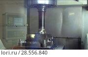 Купить «Precision milling CNC machine tool makes part», видеоролик № 28556840, снято 28 мая 2018 г. (c) Андрей Радченко / Фотобанк Лори