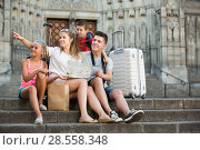 Купить «Family with kids sitting on stone stairs near cathedral», фото № 28558348, снято 24 июля 2017 г. (c) Яков Филимонов / Фотобанк Лори