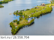 Купить «Aerial view of Kizhi island with old russian wooden architecture in Karelia. Summer sunny day.», эксклюзивное фото № 28558704, снято 9 июня 2018 г. (c) Сергей Цепек / Фотобанк Лори