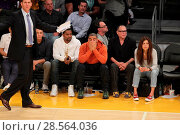 Купить «Celebrities at the Lakers game. The Los Angeles Lakers defeated the Golden State Warriors by the final score of 117-97 at Staples Center in downtown Los...», фото № 28564036, снято 4 ноября 2016 г. (c) age Fotostock / Фотобанк Лори