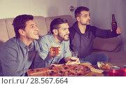 Купить «Three men emotionally watching sports on tv while drinking beer with pizza», фото № 28567664, снято 10 января 2018 г. (c) Яков Филимонов / Фотобанк Лори