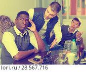 Купить «Chagrined man with friends», фото № 28567716, снято 23 февраля 2018 г. (c) Яков Филимонов / Фотобанк Лори