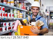 Купить «foreman holding basket with tools», фото № 28567840, снято 13 сентября 2017 г. (c) Яков Филимонов / Фотобанк Лори
