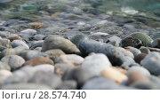 Купить «Fragment of sea coast with a pebble beach», видеоролик № 28574740, снято 5 июня 2018 г. (c) Володина Ольга / Фотобанк Лори